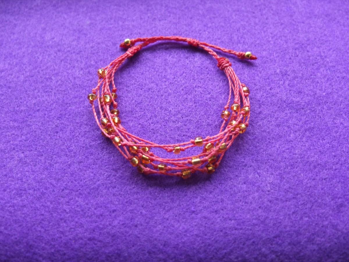 photo Amérique du sud perles de verre rose bonbon